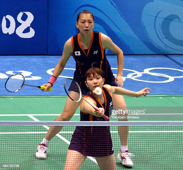 Kumiko Ogura and Reiko Shiota of Japan compete against Yu Yang and Du Jing of China in the Badmminton Women's Doubles Quarter final at the Beijing...