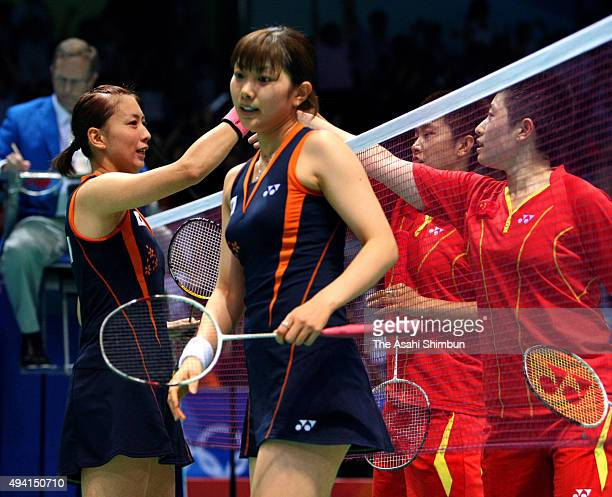 Kumiko Ogura and Reiko Shiota of Japan react after their defeat against Yu Yang and Du Jing of China in the Badmminton Women's Doubles Quarter final...