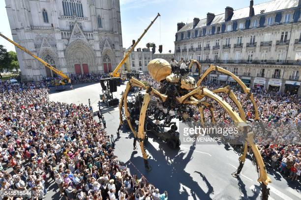 Kumo a mechanical spider made of wood and steel by Les Machines de L'Ile factory is presented to the public for the first time in front of the Nantes...