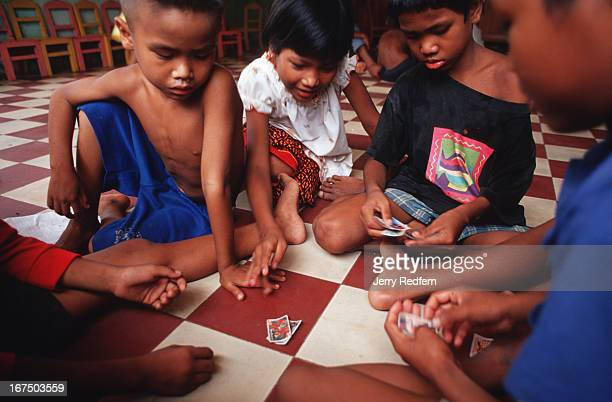Kun thy at center learns gambling with the boys while playing with toy cards at the Chea Sim orphanage There are 55 small children and so few...