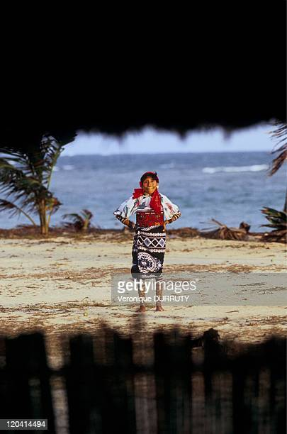Kuna woman in traditional costume with the mola El Porvenir island in San Blas Panama The mola is a traditional textile art form made by the Kuna...