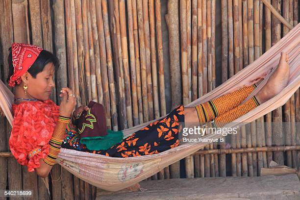kuna woman in traditional outfits making mola - mola stock pictures, royalty-free photos & images