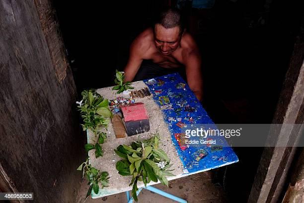 A Kuna Yala native holds a miniature model depicting water pollution in San Blas islands northern Panama
