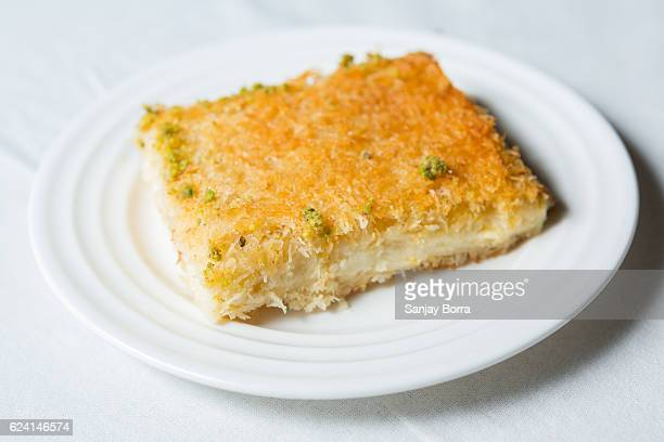 Kunafa served on a plate on a white background
