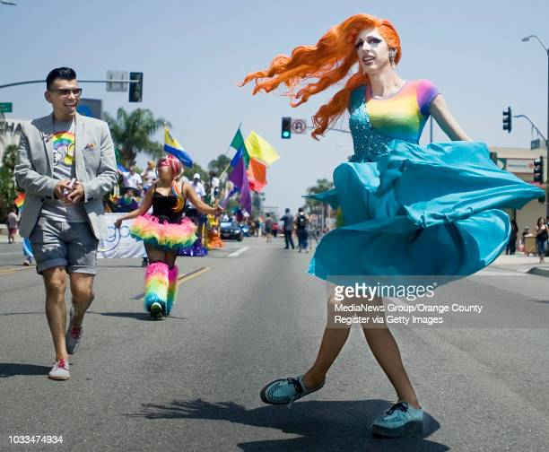 Kunda F Couture spins down the Orange County Pride ÒLive Your LifeÓ parade in downtown Santa Ana on Saturday Manny Muro who is running for Mr Gay...