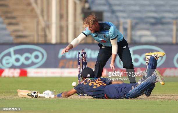 Kundal Pandya of India dives to make their ground as Ben Stokes of England attempts to gather the ball during the 3rd One Day International match...