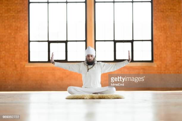 Kundalini. Man practicing yoga. Meditating in lotus pose
