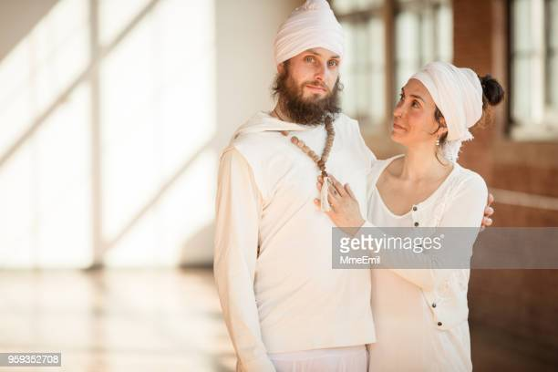 Kundalini Wedding in traditional clothing. A couple getting married