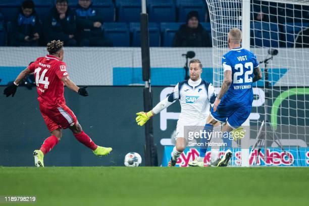 Kunde Malong of Mainz scores his team's third goal past Goalkeeper Oliver Baumann of Hoffenheim during the Bundesliga match between TSG 1899...