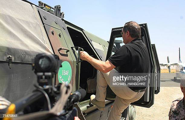 German defence minister Franz Josef Jung enters a Dingo tank of the German armed forces Bundeswehr 18 July 2006 at the airport of Kunduz Jung is on a...