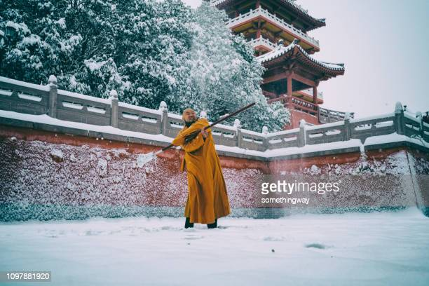 kung fu monk warrior in shaolin temple china - shaolin monastery stock photos and pictures