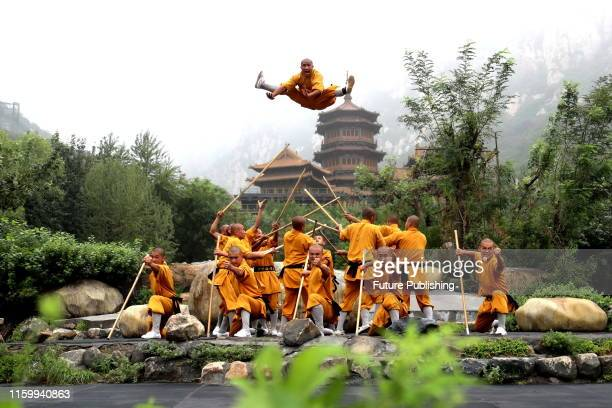 Kung Fu monks from the renowned Shaolin Temple rehearse the real-life scenery performance Zen & Music Shaolin in Dengfeng in central China's Henan...