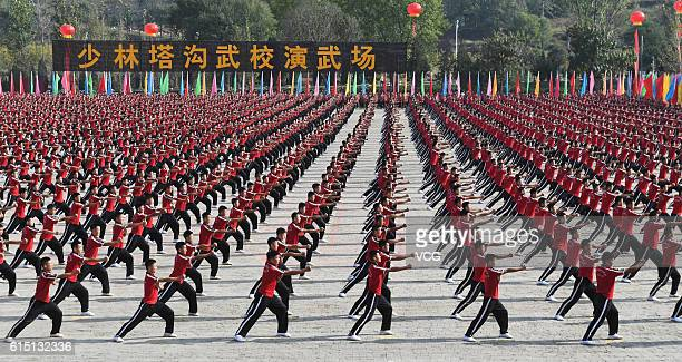 Kung fu students perform during the opening ceremony of the 11th Zhengzhou International Shaolin Martial Arts Festival on October 16 2016 in...