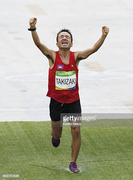 Kuniaki Takizaki known as comedian Hiroshi Neko representing Cambodia finishes the men's marathon in 139th place at the Rio de Janeiro Olympics on...