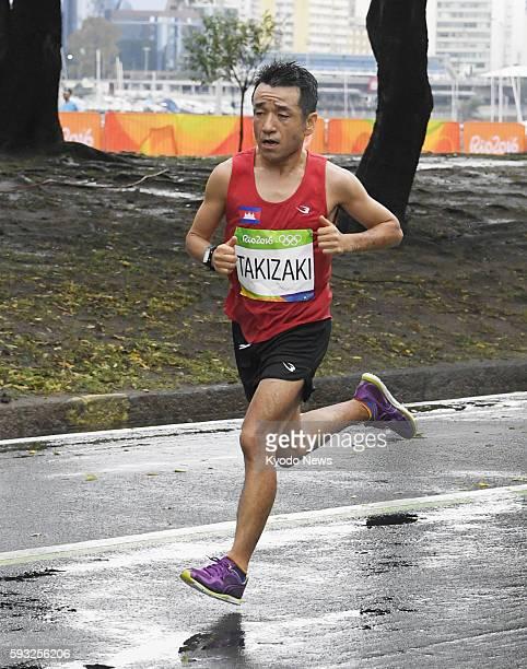 Kuniaki Takizaki known as comedian Hiroshi Neko representing Cambodia runs during the men's marathon at the Rio de Janeiro Olympics on Aug 21 2016...
