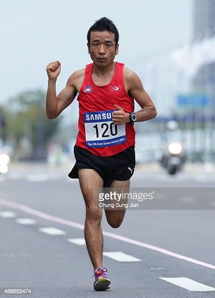 Kuniaki Takizaki of Cambodia compete in the Men's Marathon during day fourteen of the 2014 Asian Games at Incheon marathon course on October 3 2014...