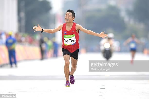 Kuniaki Takizaki of Cambodia races to the finish line during the Men's Marathon on Day 16 of the Rio 2016 Olympic Games at Sambodromo on August 21...
