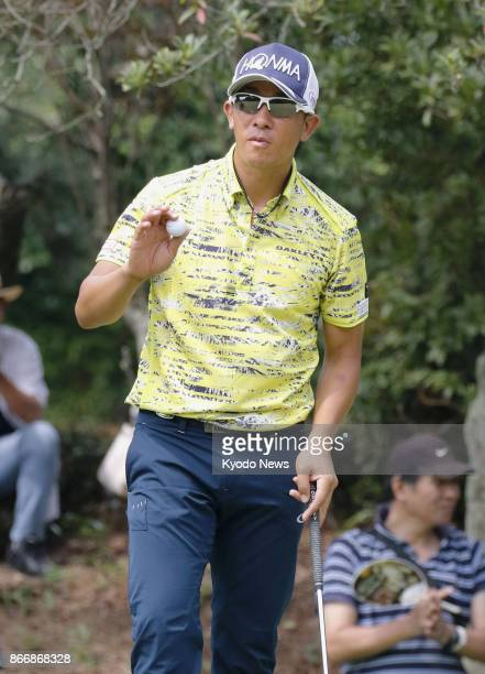 Kunihiro Kamii of Japan acknowledges after his birdie on the 13th green during the third round of the RIZAP KBC Augusta at Keya Golf Club on August...