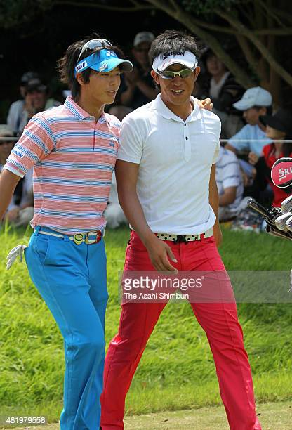 Kunihiro Kamii of Japan is congratulated by Ryo Ishikawa for his second holeinone in a tournament during the third round of the Vana H Cup KBC...