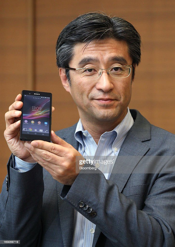 Kunimasa Suzuki, president and chief executive officer of Sony Mobile Communications, holds a Sony Corp. Xperia Z smartphone during an interview in Tokyo, Japan, on Monday, March 4, 2013. Sony plans to make its mobile-device business profitable next fiscal year as it boosts shipments of smartphones, Suzuki said. Photographer: Junko Kimura/Bloomberg via Getty Images