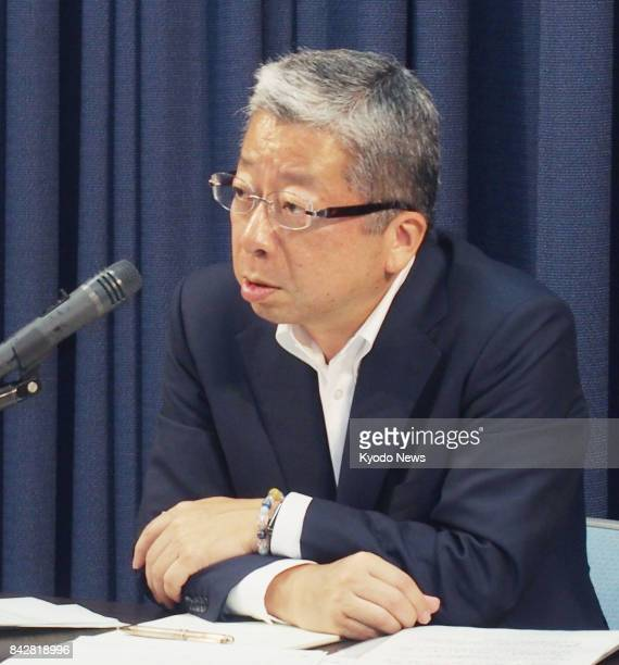 Kunio Yokoyama president of Japan Post Co speaks at a press conference in Tokyo on Sept 5 2017 The company said it will raise basic shipping fees for...