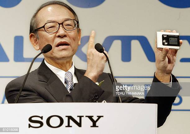 Kunitake Ando president of Japan's electronics giant Sony introduces the world's lightest and smallest portable audio player equipped with 20...