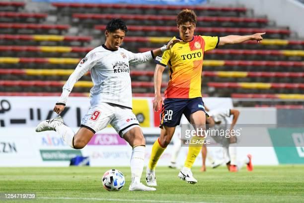 Kunitomo SUZUKI Giravanz Kitakyushu and LEE Yong Jick of FC Ryukyu compete for the ball during the J.League Meiji Yasuda J2 match between Giravanz...
