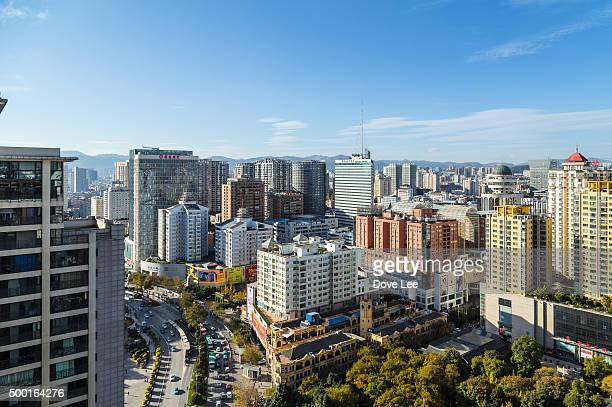 kunming cityscape - kunming stock photos and pictures