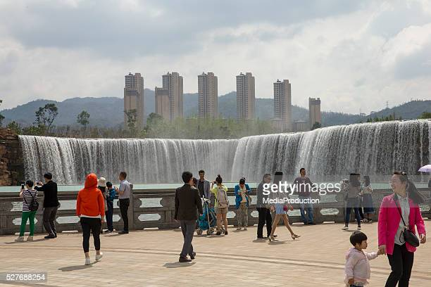 kunming waterfall park - kunming stock photos and pictures