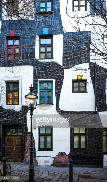 kunsthaus, street view outside the museum hundertwasser in vienna, austria - vsojoy stock pictures, royalty-free photos & images