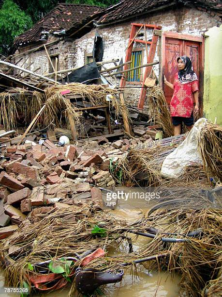 Kuntiana looks at her destoryed house following a flood in her neighbourhood in Ponorogo of East Java province 27 December 2007 Hundreds of...