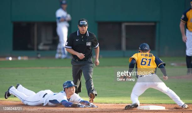 Kuo Chen Fan out at the second base at the bottom of the 2nd inning during the CPBL game between Fubon Guardians and CTBC Brothers at the Xinzhuang...