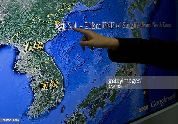 Kuo Kaiwen director of Taiwan's Seismology Center points at the locations from a monitor showing North Korea's first hydrogen bomb test site in...