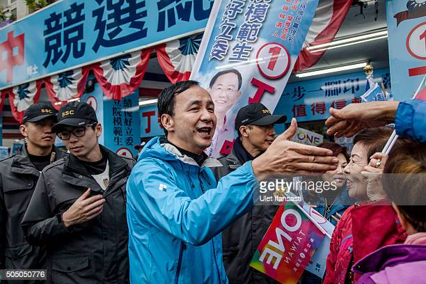 Kuomintang Party presidential candidate Eric Chu, shakehands with the supporters during rally campaign ahead of the Taiwanese presidential election...