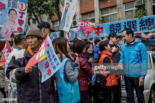 Kuomintang Party presidential candidate Eric Chu , shakehands with the supporters during rally campaign ahead of the Taiwanese presidential election...