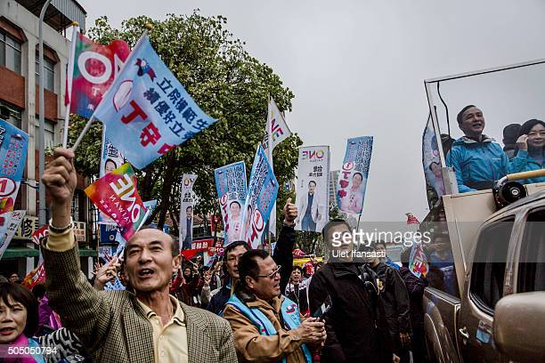 Kuomintang Party presidential candidate Eric Chu , waves to the supporters from a truck as he parades through the streets of Taiwan during rally...