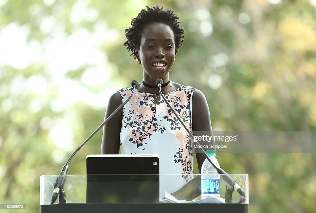 Kuoth Wiel speaks at the Amnesty International Tapestry Honoring John Lennon Unveiling at Ellis Island on July 29, 2015 in New York City.