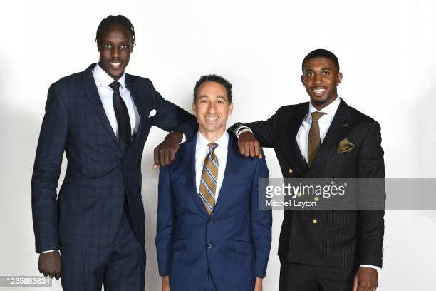 Kur Kuath. Head coach Shaka Smart, and Darryl Morsell of the Marquette Golden Eagles pose for a photo during the Big East Media Day at Madison Square...