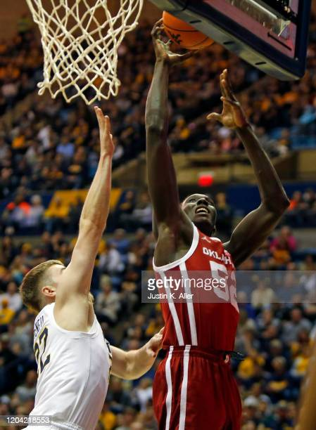 Kur Kuath of the Oklahoma Sooners drives to the rim against the West Virginia Mountaineers at the WVU Coliseum on February 29 2020 in Morgantown West...