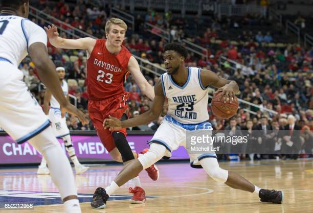 Kuran Iverson of the Rhode Island Rams drives to the basket against Peyton Aldridge of the Davidson Wildcats in the Semifinals of the men's Atlantic...
