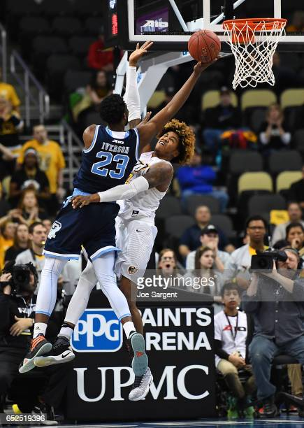 Kuran Iverson of the Rhode Island Rams goes up for a shot against Justin Tillman of the Virginia Commonwealth Rams during the championship game of...
