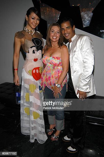 Kurara Chibana Paula Shuggart and Marco De La Cruz attend Miss Universe Post Pageant VIP Party hosted by Chuck Nabit Dave Geller Ed St John Greg...