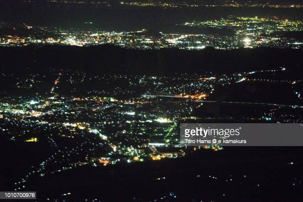 Kurashiki city in Okayama prefecture in Japan night time aerial view from airplane