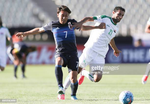 Kurata Shu of Japan and Saad Abdolameer of Iraq in action during the FIFA World Cup Russia Asian Final Qualifier match between Iraq and Japan at PAS...
