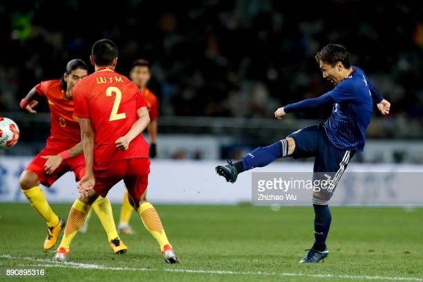 Kurata Shu of Japan shoots during the EAFF E1 Men's Football Championship match between Japan and China at Ajinomoto Stadium on December 12 2017 in...