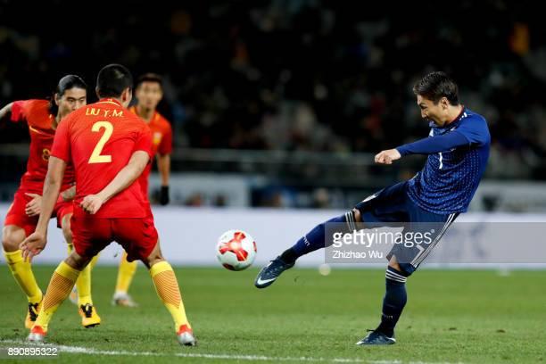 Kurata Shu shoots during the EAFF E1 Men's Football Championship match between Japan and China at Ajinomoto Stadium on December 12 2017 in Chofu...