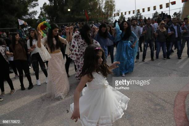 A Kurd celebrates on March 21 2013 Nowruz the Persian New Year festival with a flag bearing a portrait of jailed Kurdish rebel chief Abdullah Ocalan...