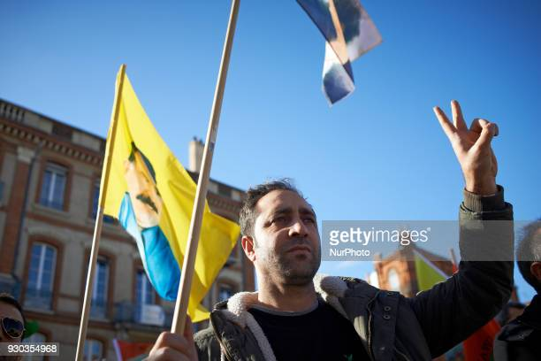 A Kurd makes the V sign as the Kurdish anthem was played Kurds demonstrate to pay tribute to French fighter Kendal Breizh killed by turkish forces in...