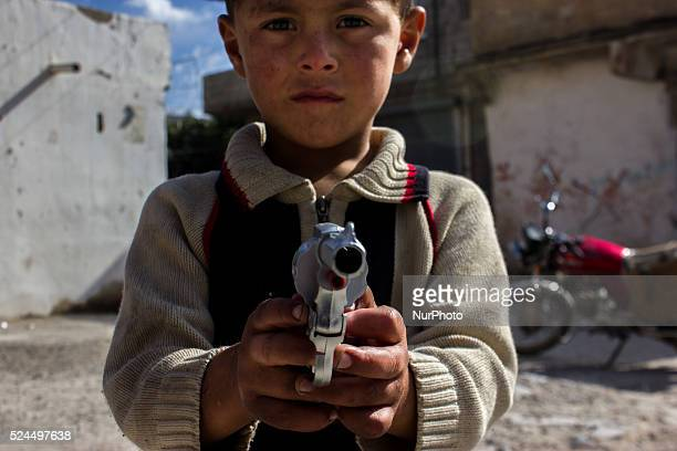 A kurd refugge boy plays with a plastic gun in the Turkish city of Suruc Sanliurfa province wich is located 6 kilometres far from the Syrian town of...