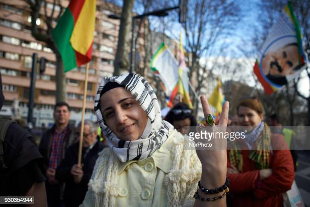 A Kurd woman makes the V sign Kurds demonstrate to pay tribute to French fighter Kendal Breizh killed by turkish forces in Afrin They also protest...